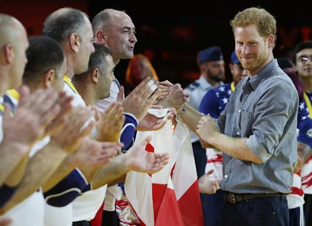 Britain's Prince Harry, patron of the Invictus Games Foundation, congratulates the Sitting Volleyball team from Georgia after presenting them with gold medal at the Invictus Games in Toronto, Ontario, Canada, September 27, 2017. REUTERS/Fred Thornhill