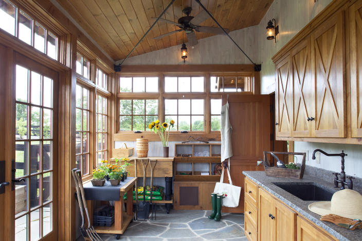 This photo provided by Rill Architects shows the inside of a garage in Emmitsburg, Md. Detached garages with a second floor, as seen in this project designed by the Bethesda, Md. based firm Rill Architects, can serve as a space to store cars while also pulling double-duty as guest suites, rooms for crafting or even a playroom for children. One section of a large garage can be used to organize planting supplies and adding an outdoor sink and counter area, as seen here, makes the space even more functional. (James Ray Spahn/Rill Architects via AP)
