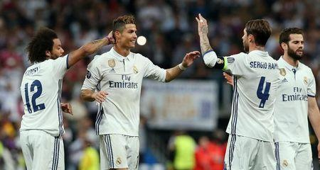Real Madrid's Cristiano Ronaldo and Sergio Ramos celebrate after the match with Marcelo