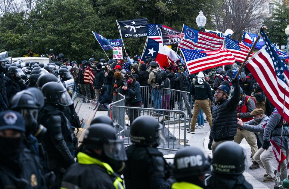 """<span class=""""caption"""">Supporters of President Donald Trump are confronted by U.S. Capitol Police officers outside the Capitol on Jan. 6, 2021. </span> <span class=""""attribution""""><span class=""""source"""">AP Photo/Manuel Balce Ceneta)</span></span>"""