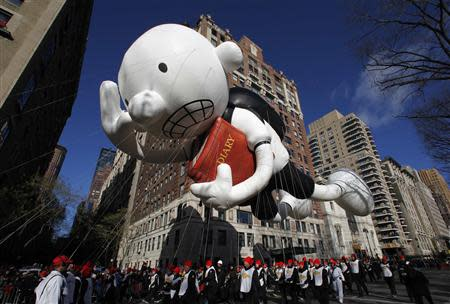The Diary of a Wimpy Kid balloon floats down Central Park West during the 87th Macy's Thanksgiving Day Parade in New York November 28, 2013. REUTERS/Gary Hershorn