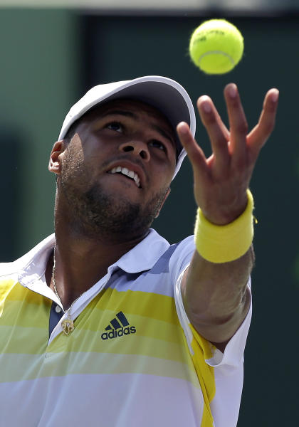 Jo-Wilfried Tsonga, of France, serves to Viktor Troicki, of Serbia, during the Sony Open tennis tournament, Saturday, March 23, 2013, in Key Biscayne, Fla. (AP Photo/Lynne Sladky)
