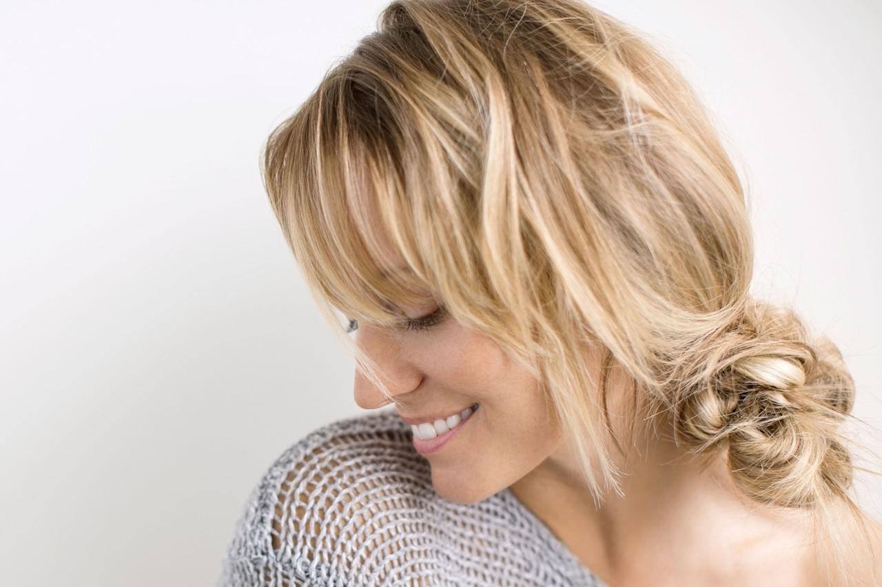 "<p>While the typical ponytail or messy bun is an easy go-to when it comes to a <a rel=""nofollow"" href=""http://www.redbookmag.com/beauty/hair/g3634/updos-for-short-hair/"">quick updo</a>, hairstylist Vanessa Ungaro from<a rel=""nofollow"" href=""http://laurenandvanessa.com/""> <u>LAUREN+VANESSA</u></a>, swears that all it takes is one additional step to amp up any updo into a new and unexpected style. </p><p><br></p><p>1. ""Part your hair on the side or in the middle and gather the ends a little higher than the nape of the neck,"" she says. </p><p>2. ""Then, place your hair into a messy bun and wrap a thick strand of hair around the elastic to conceal it, securing with a bobby pin."" While wrapping a strand of hair around a ponytail can be pretty standard, adding that step around a messy bun updates your look into a newer, classier version with a bit more personality. </p><p><br></p><p><strong>RELATED: <a rel=""nofollow"" href=""http://www.redbookmag.com/beauty/hair/advice/g2030/remedies-for-dry-hair/"">The 50 Most Iconic Updos of All Time</a><span><a rel=""nofollow"" href=""http://www.redbookmag.com/beauty/hair/advice/g2030/remedies-for-dry-hair/""></a></span></strong><br></p>"