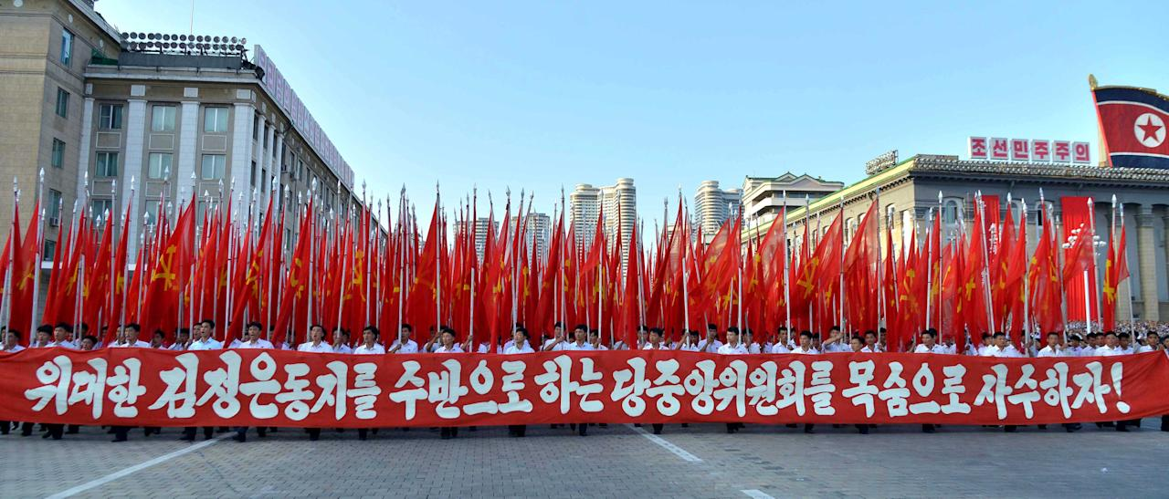 <p>Citizens came ared with flags and placards. (Reuters) </p>