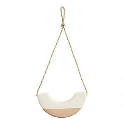 """<h2>World Market Half-Circle Hanging Planter<br></h2>If you want a vessel that promises to stand out, consider this sculptural, half-circle planter crafted from glazed earthenware. <br> <br> <strong>Cost Plus World Market</strong> Ivory And Tan Half Circle Modern Hanging Planter, $, available at <a href=""""https://www.worldmarket.com/product/ivory+and+tan+half+circle+modern+hanging+planter.do"""" rel=""""nofollow noopener"""" target=""""_blank"""" data-ylk=""""slk:Cost Plus World Market"""" class=""""link rapid-noclick-resp"""">Cost Plus World Market</a>"""