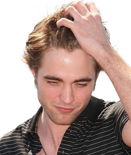Robert Pattinson photos: Oooh, the tease! It's as if Robert knows we'll be refreshing this page over and over.