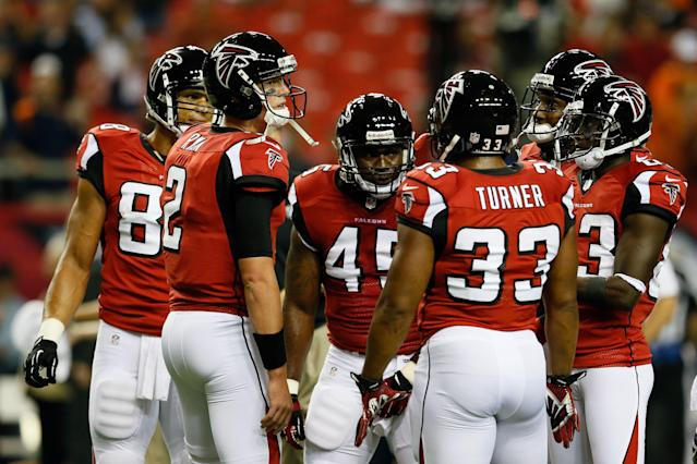 ATLANTA, GA - SEPTEMBER 17: Quarterback Matt Ryan #2 of the Atlanta Falcons talks with his team during warm ups prior to their game against the Denver Broncos at the Georgia Dome on September 17, 2012 in Atlanta, Georgia. (Photo by Kevin C. Cox/Getty Images)