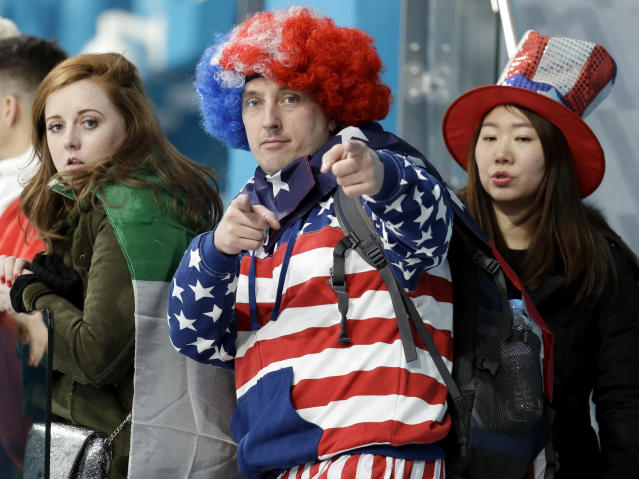 A man dressed in the colors of the American flag gestures as he watches the men's curling matches at the 2018 Winter Olympics in Gangneung, South Korea, Thursday, Feb. 15, 2018. (AP Photo/Aaron Favila)