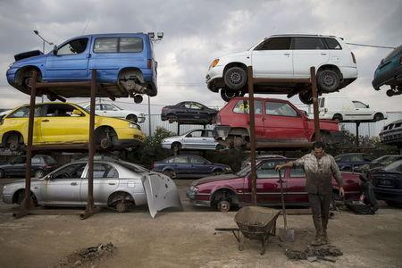 A man works in a scrapyard at a recycling company in the town of Elefsina, near Athens, Greece June 30, 2015. REUTERS/Marko Djurica