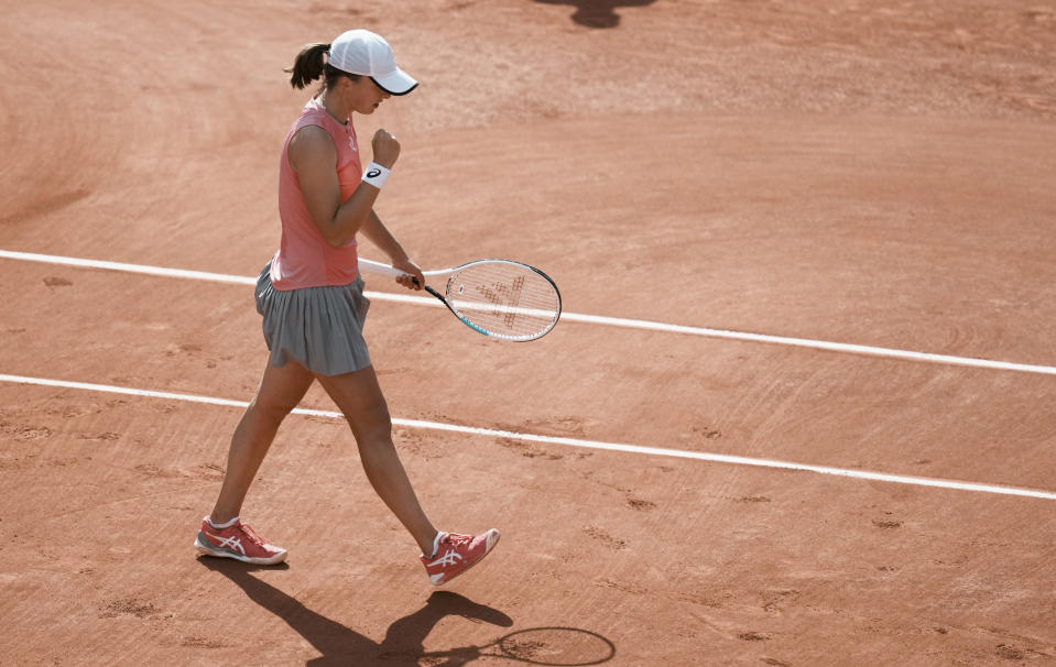 Poland's Iga Swiatek ccelebrates after defeating Estonia's Anett Kontaveit during their third round match on day 7, of the French Open tennis tournament at Roland Garros in Paris, France, Saturday, June 5, 2021. (AP Photo/Thibault Camus)