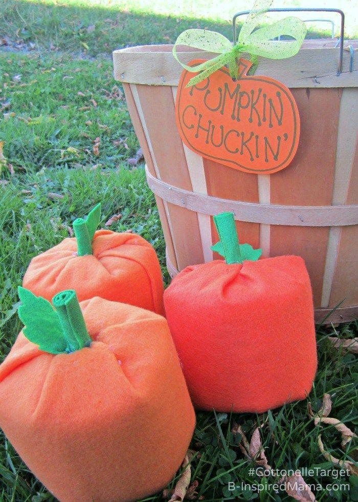"""<p>The secret to this tossing game? Wrapping whole rolls of toilet paper in orange felt.</p><p><em><a href=""""http://b-inspiredmama.com/pumpkin-halloween-game/"""" rel=""""nofollow noopener"""" target=""""_blank"""" data-ylk=""""slk:Get the tutorial at B-Inspired Mama »"""" class=""""link rapid-noclick-resp"""">Get the tutorial at B-Inspired Mama »</a></em><br></p>"""