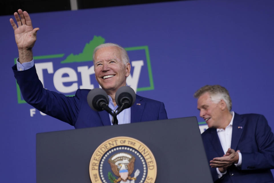 President Joe Biden waves as he arrives to speak at a campaign event for Virginia democratic gubernatorial candidate Terry McAuliffe, right, at Lubber Run Park, Friday, July 23, 2021, in Arlington, Va. (AP Photo/Andrew Harnik)