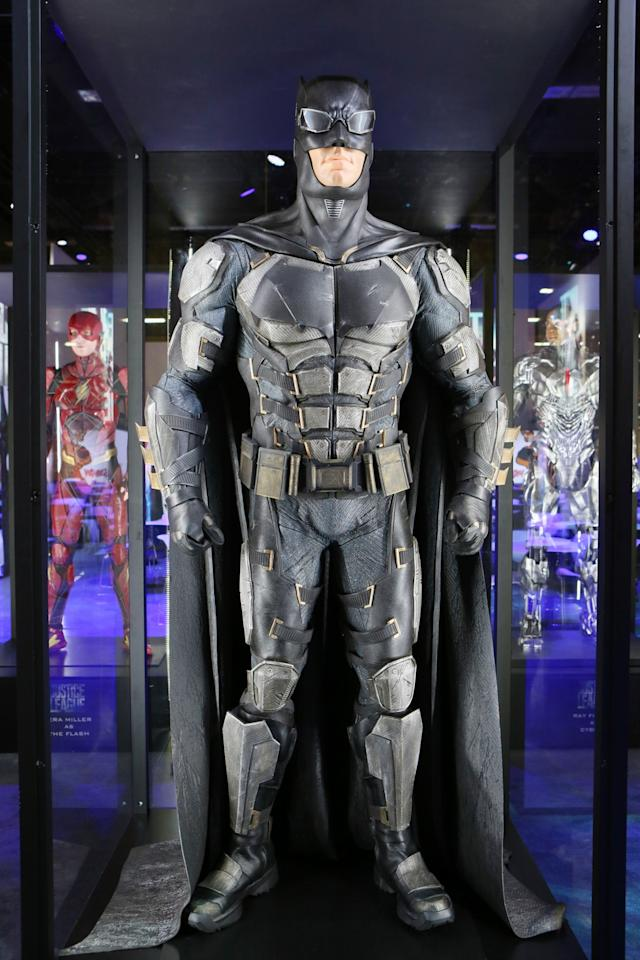 <p>Ben Affleck's back as the Dark Knight in a retooled costume reminicent of the <i>Arkham</i> video games. Dig those Bat-goggles! (Credit: Warner Bros.) </p>