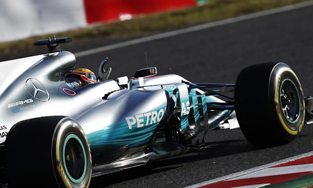 <p>Lewis Hamilton celebrates as he returns to the pits after winning the Japanese Grand Prix at Suzuka.</p>