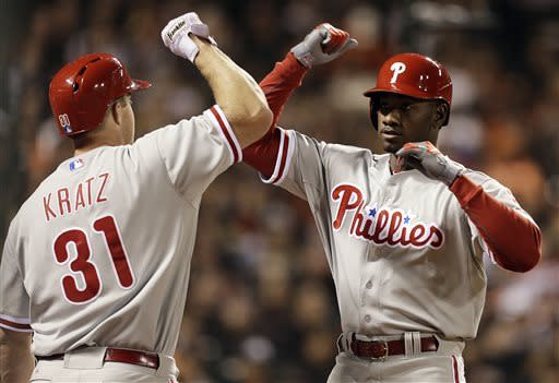 Philadelphia Phillies' Domonic Brown, right, is congratulated by Erik Kratz (31) after hitting a home run off San Francisco Giants' Madison Bumgarner in the fifth inning of a baseball game, Monday, May 6, 2013, in San Francisco. (AP Photo/Ben Margot)