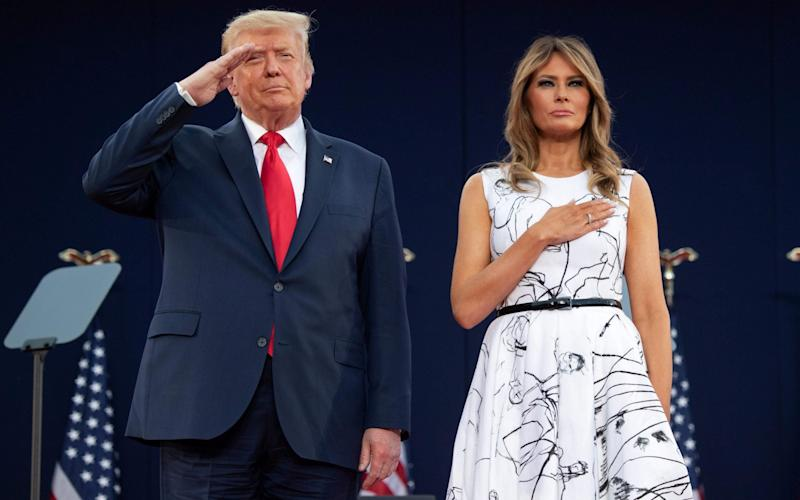 US President Donald Trump and First Lady Melania Trump during the national anthem - SAUL LOEB/AFP