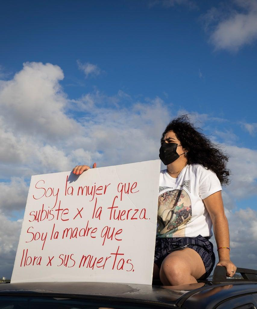 People gather at the Teodoro Moscoso bridge in order to protest and demand justice for the most recent feminiced against Keishla Rodríguez and Andrea Ruiz Costas, in San Juan, Puerto Rico, on May 2, 2021. (Photo by Alejandro Granadillo/NurPhoto via Getty Images)