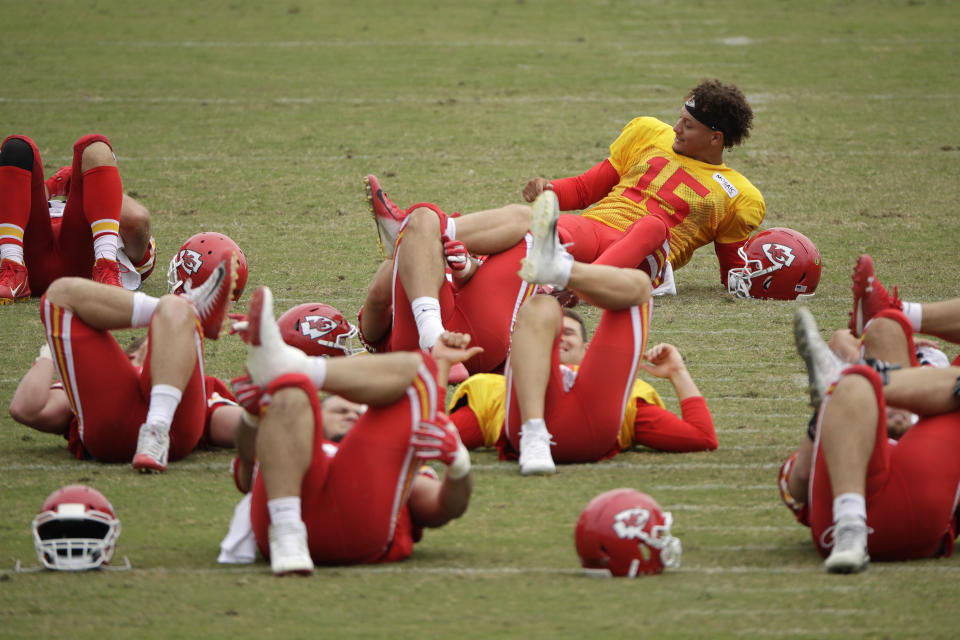 Kansas City Chiefs quarterback Patrick Mahomes stretches with teammates during 2019 training camp in St. Joseph, Missouri. (AP Photo/Charlie Riedel)