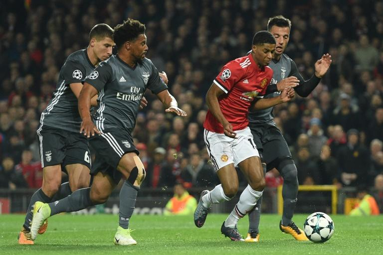 Manchester United's Marcus Rashford (2nd R) is fouled in the penalty area by Benfica's Andreas Samaris (R) leading to a penalty scored by Manchester United's Daley Blind during the UEFA Champions League Group A football match October 31, 2017