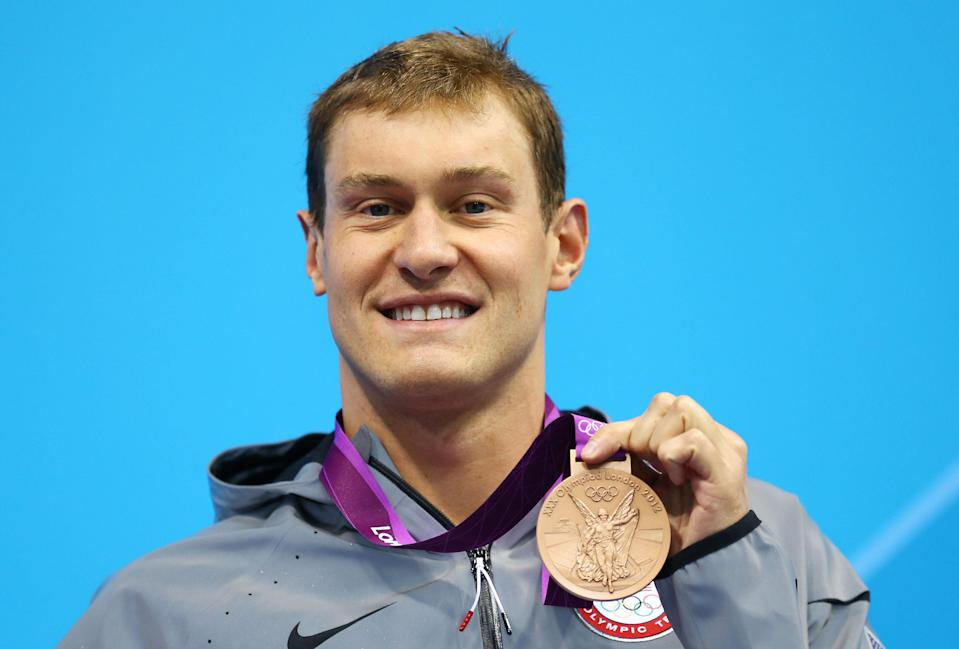 """<a href=""""http://sports.yahoo.com/olympics/swimming/peter-vanderkaay-1135313/"""" data-ylk=""""slk:Peter Vanderkaay"""" class=""""link rapid-noclick-resp"""">Peter Vanderkaay</a> of the United States celebrates with his bronze medal during the medal ceremony for the Men's 400m Freestyle on Day One of the London 2012 Olympic Games at the Aquatics Centre on July 28, 2012 in London, England. (Photo by Al Bello/Getty Images)"""