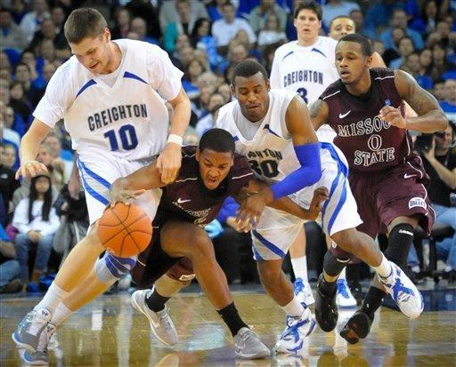 Creighton's Grant Gibbs (10) and Antoine Young (30) battle with Missouri's Jarmar Gully (5) and Anthony Downing (0) for a loose ball during their NCAA college basketball game Wednesday Dec 28, 2011 in Omaha, Neb (AP Photo/Dave Weaver)