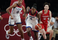 United States' Jewell Loyd (4), center, brings the ball upcourt during women's basketball preliminary round game against Japan at the 2020 Summer Olympics, Friday, July 30, 2021, in Saitama, Japan. (AP Photo/Eric Gay)