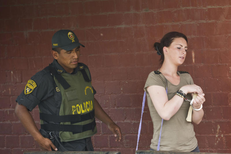 File picture taken on December 17, 2013 shows Irish national Michaella McCollum (R) arriving at the Sarita Colonia courtroom before being sentenced for trying to smuggle a total of 11 kilos of cocaine out of Peru on a flight to Spain