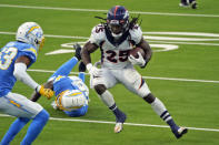 Denver Broncos running back Melvin Gordon (25) runs against the Los Angeles Chargers during the second half of an NFL football game Sunday, Dec. 27, 2020, in Inglewood, Calif. (AP Photo/Ashley Landis)