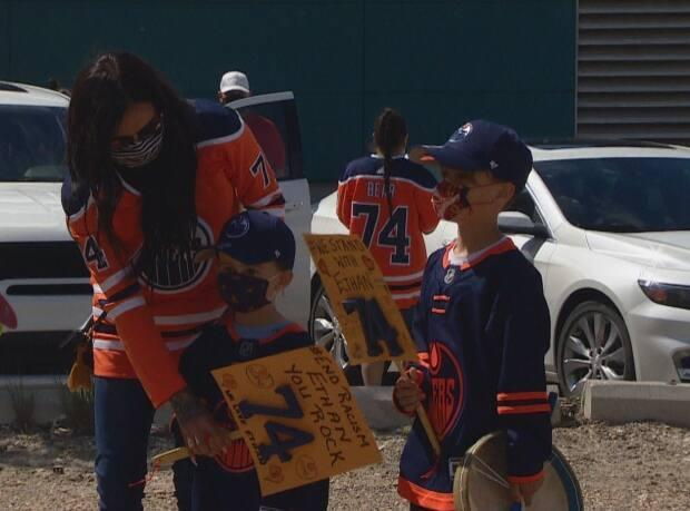 Fans wearing orange and blue Oilers jerseys, most branded with Bear's name and number 74, gathered outside Rogers Place arena in Edmonton to denounce racism on Saturday, May 29, 2021.  (Gabrielle Brown/CBC Radio-Canada - image credit)