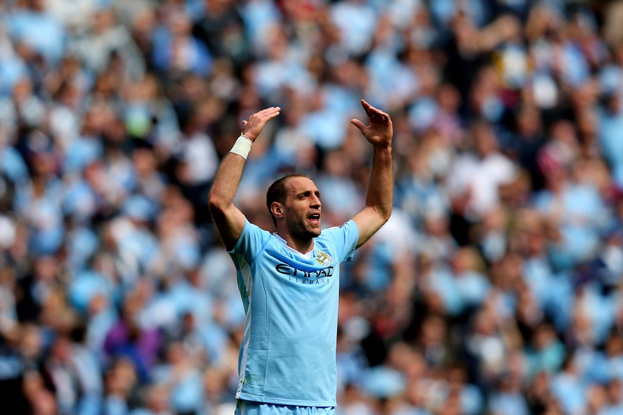 MANCHESTER, ENGLAND - MAY 13:  Pablo Zabaleta of Manchester City celebrates after scoring the opening goal during the Barclays Premier League match between Manchester City and Queens Park Rangers at the Etihad Stadium on May 13, 2012 in Manchester, England.  (Photo by Alex Livesey/Getty Images)