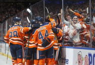 Edmonton Oilers celebrate the overtime win against the Boston Bruins during NHL hockey action in Edmonton, Alberta, Thursday Oct. 18, 2018. (Jason Franson/The Canadian Press via AP)