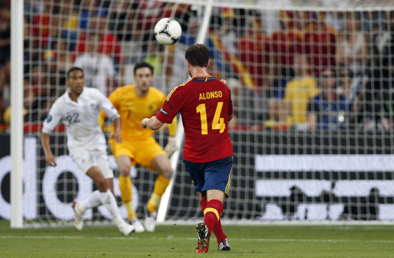 Spain's Xabi Alonso scores the opening goal during the Euro 2012 soccer championship quarterfinal match between Spain and France in Donetsk, Ukraine, Saturday, June 23, 2012. (AP Photo/Michael Sohn)