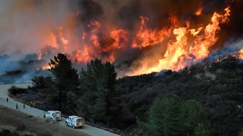 Fire fighters attack the Thomas Fire's north flank with backfires as they continue to fight a massive wildfire north of Los Angeles, near Ojai, on Dec. 9, 2017. (Gene Blevins / Reuters)