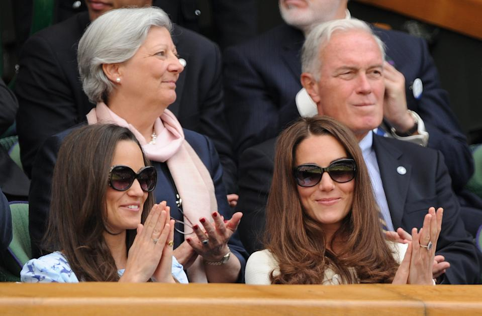 The Duchess of Cambridge is joined by lookalike sister, Pippa Middleton, as they enjoy the men's final (Andy Murray vs. Roger Federer) from the royal box in 2012. <em>[Photo: Getty Images]</em>
