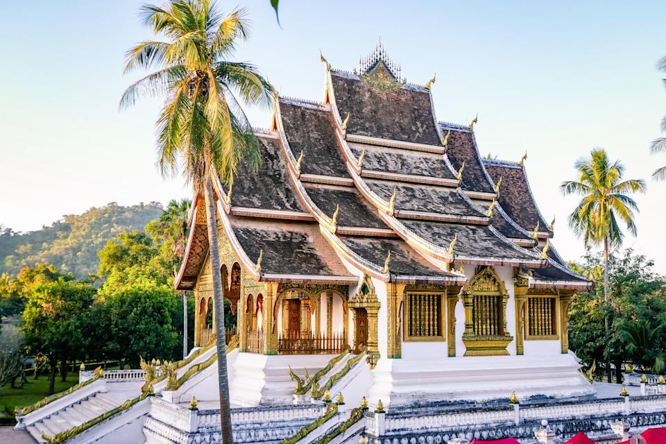 """Luang Prabang might just be <a href=""""https://www.cntraveler.com/story/why-luang-prabang-is-the-ideal-southeast-asian-city?mbid=synd_yahoo_rss"""" rel=""""nofollow noopener"""" target=""""_blank"""" data-ylk=""""slk:the ideal southeast Asian city"""" class=""""link rapid-noclick-resp"""">the ideal southeast Asian city</a>. You won't find temples or ruins, but you will find a culture filled with happiness and a pure enjoyment of life. You can walk the entire length of the city center in about 20 minutes, but be prepared to stop frequently as you pass local vendors and food stalls selling the best bowl of noodles you'll ever have. At night, the city enters its second act as a smoky dreamscape, punctuated by noisy, colorful <em>tuk-tuks</em> driving by. And perhaps it's that ever-moving, yet heat-induced slow pace of life that makes Luang Prabang so very special."""