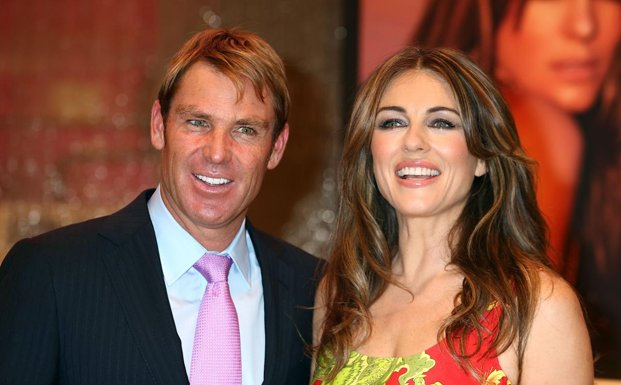LONDON, ENGLAND - MAY 23:  Elizabeth Hurley makes a personal appearance, joined by her fiancee Shane Warne to launches her new bed linen collection at House of Fraser on May 23, 2012 in London, England.  (Photo by Tim Whitby/Getty Images)