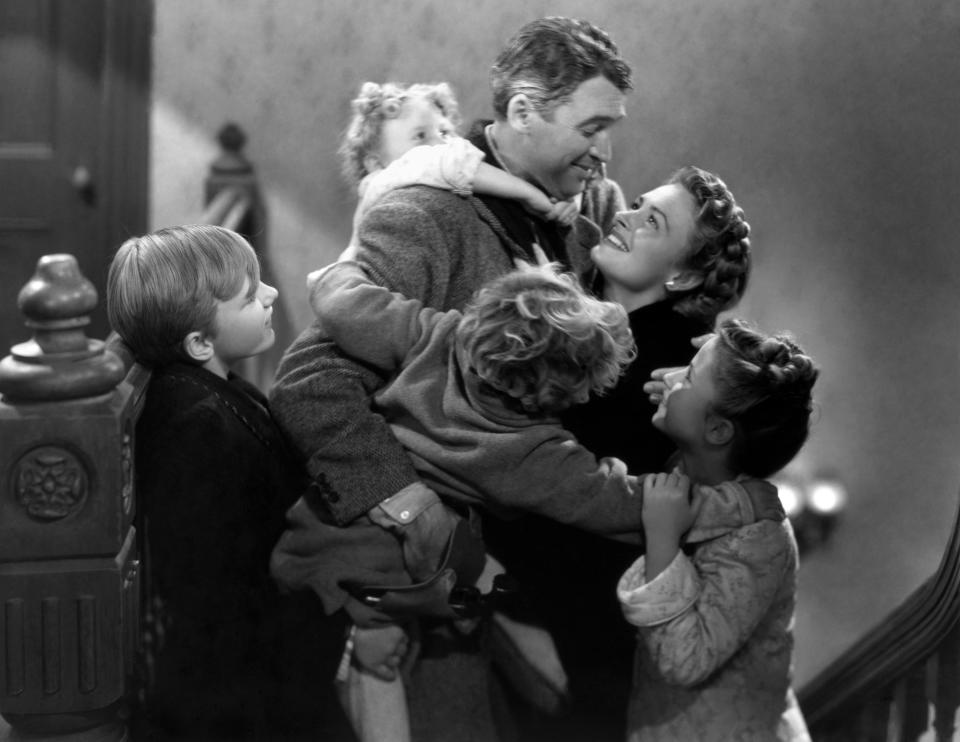 Clockwise from top: James Stewart, Donna Reed, Carol Coombs, Jimmy Hawkins, Larry Simms and Karolyn Grimes. (Photo by Herbert Dorfman/Corbis via Getty Images)