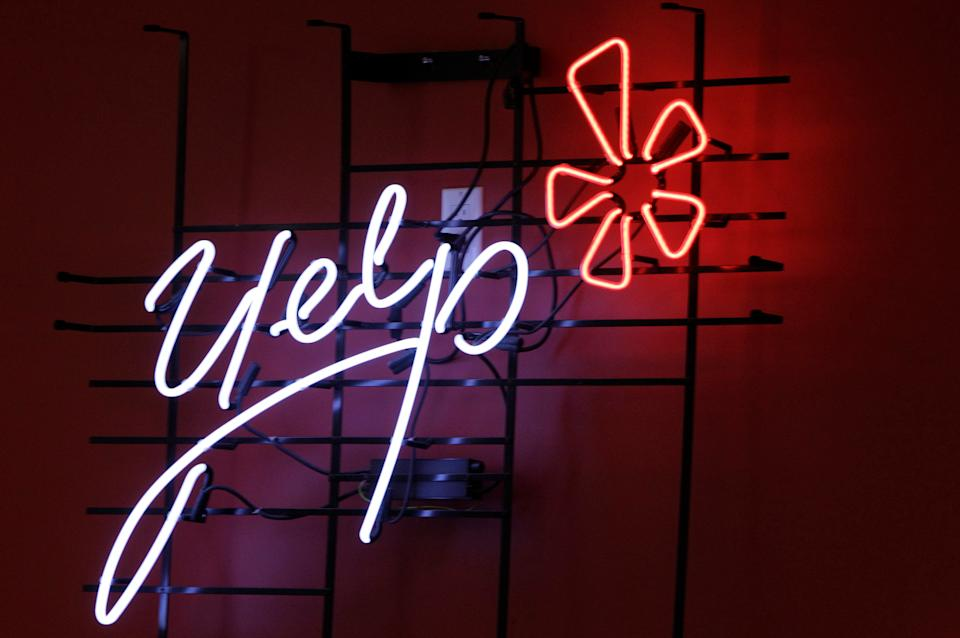 <p> FILE - In this Oct. 26, 2011 file photo, the logo of the online reviews website Yelp is shown in neon on a wall at the company's new Manhattan offices in New York. Online reviews site Yelp is expected to price its initial public offering of stock on Thursday , March 1, 2012, and become the latest in a long line of social websites going public. (AP Photo/Kathy Willens, File) </p>
