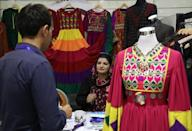 Afghan woman vendor talks with customers during a women ability exhibition in Kabul