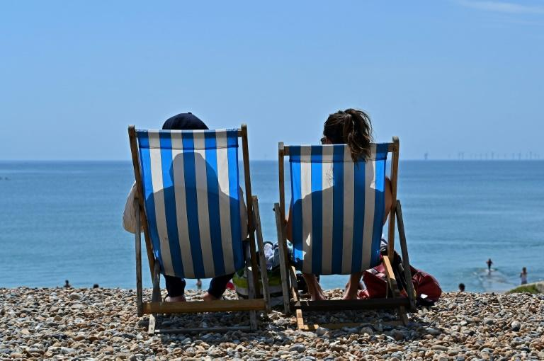 "With overseas travel considered a ""risky"" option owing to the fallout from the virus, resorts such as Brighton on the south coast are looking to gain from those seeking sunshine as well as home comforts (AFP Photo/Glyn KIRK)"