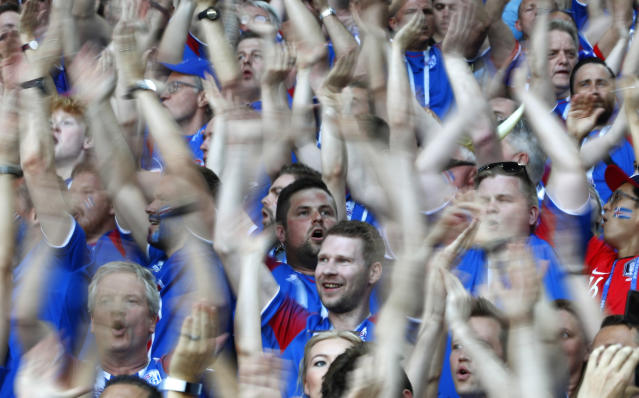 <p>Iceland fans perform their famous 'hu'-chant prior to the group D match against Argentina </p>
