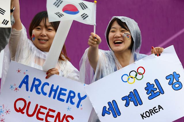 LONDON, ENGLAND - JULY 29: Lorea fans celebrate in the Women's Team Archery Semi Final between Korea and Japan on Day 2 of the London 2012 Olympic Games at Lord's Cricket Ground on July 29, 2012 in London, England. (Photo by Paul Gilham/Getty Images)