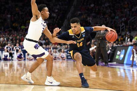 Mar 22, 2019; San Jose, CA, USA; UC Irvine Anteaters guard Evan Leonard (14) drives around Kansas State Wildcats guard Kamau Stokes (3) during the second half in the first round of the 2019 NCAA Tournament at SAP Center. Mandatory Credit: Kelley L Cox-USA TODAY Sports