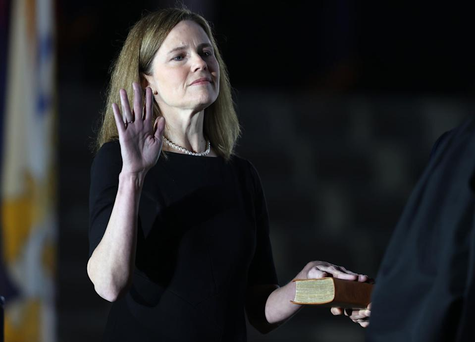WASHINGTON, DC - OCTOBER 26: U.S. Supreme Court Associate Justice Amy Coney Barrett is sworn in by Supreme Court Associate Justice Clarence Thomas during a ceremonial swearing-in event on the South Lawn of the White House October 26, 2020 in Washington, DC. The Senate confirmed Barrett's nomination to the Supreme Court today by a vote of 52-48. (Photo by Tasos Katopodis/Getty Images)