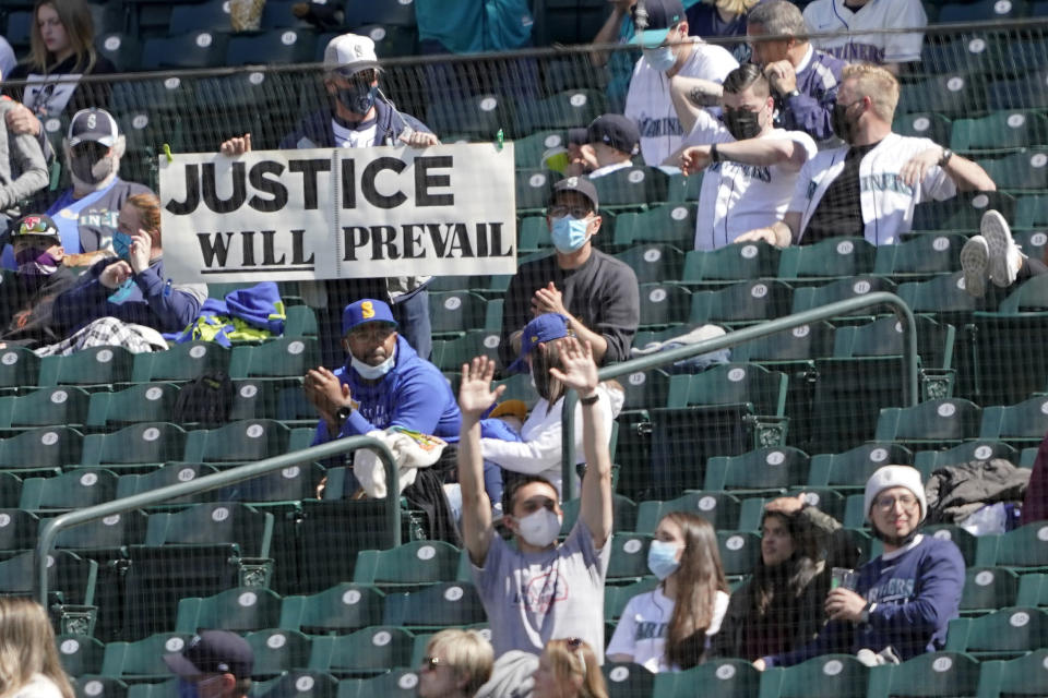 A fan holds a sign supporting Seattle Mariners starting pitcher Justus Sheffield during the fifth inning of a baseball game between the Mariners and the Los Angeles Angels, Sunday, May 2, 2021, in Seattle. (AP Photo/Ted S. Warren)