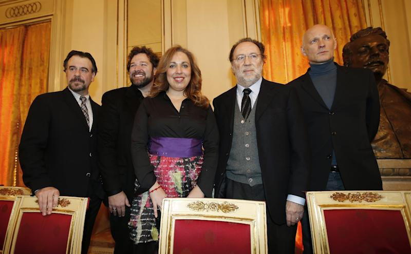 From left: baritone Carlos Alvarez, tenor Bryan Hymel, Maria Jose Siri, conductor Riccardo Chailly and Latvian theatre director Alvis Hermanis pose for photographers prior to the start of the press conference at the La Scala theater in Milan, Italy, Wednesday, Nov. 30, 2016. La Scala will open its season on Dec. 7 with Giacomo Puccini's Madama Butterfly. (AP Photo/Antonio Calanni)