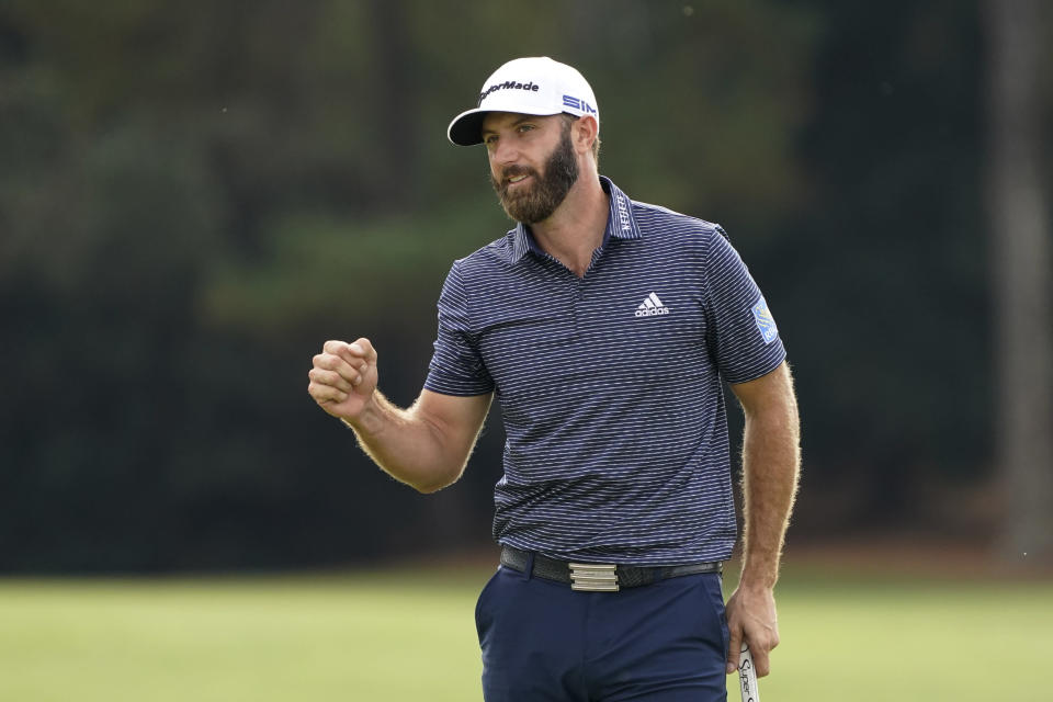 Dustin Johnson pumps his fist after wining the the Masters golf tournament Sunday, Nov. 15, 2020, in Augusta, Ga. (AP Photo/Charlie Riedel)