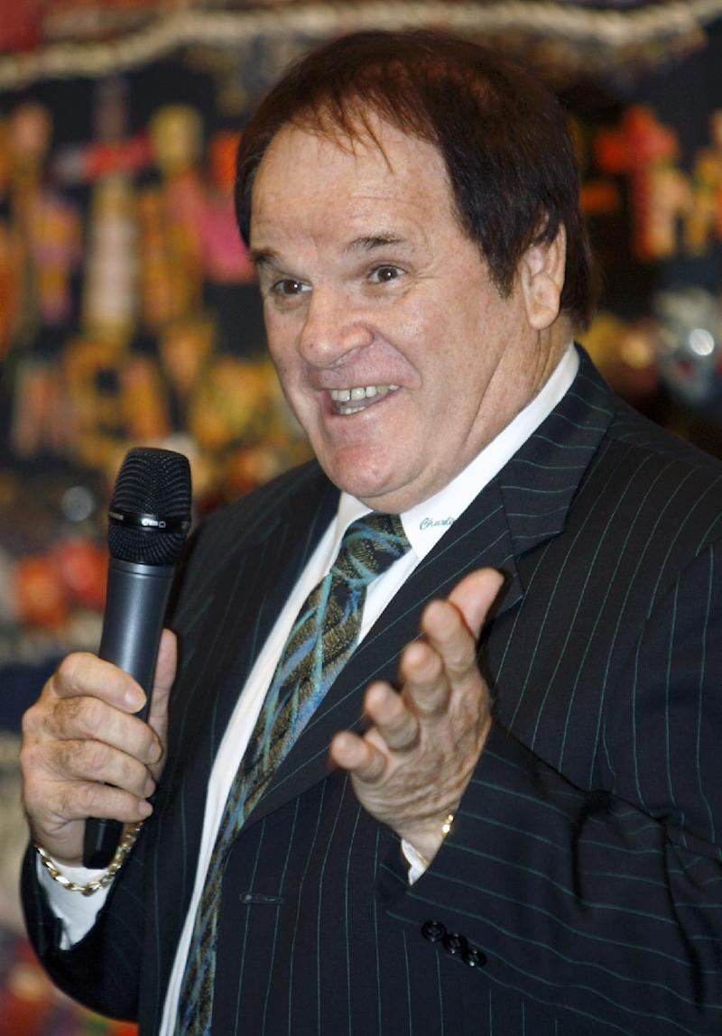 FILE - This May 14, 2011 file photo shows former Major League Baseball great Pete Rose speaking at the Ohio Justice & Policy Center's inaugural gala at the National Underground Railroad Freedom Center, in Cincinnati. Rose is taking a swing at his own reality TV show. Cable's TLC network says it has started production on an unscripted series to chronicle the lives of baseball's all-time hitting leader and his fiancee, model Kiana Kim.  (AP Photo/David Kohl, File)