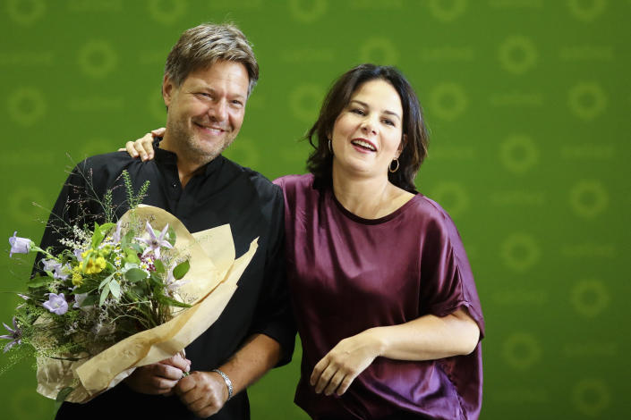 In this Monday, Sept. 2, 2019 file photo, Green party leader Annalena Baerbock congratulates her co-leader Robert Habeck to his birthday as they arrive for a party's board meeting to discus yesterday's state elections in Saxony and Brandenburg at the headquarters in Berlin, Germany. On Monday, April 19, 2021 the Green party announced that Annalena Baerbock will run as top candidate for chancellor at the national election in September 2021. (AP Photo/Markus Schreiber, file)