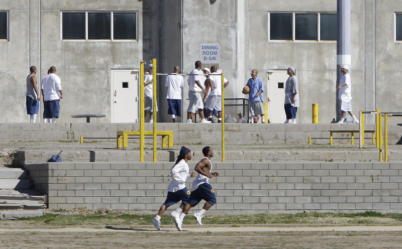 FILE -- in this photo taken Tuesday, Feb. 26, 2013 file photo, inmates workout in the exercise yard of Housing Unit B at California State Prison Sacramento, near Folsom, Calif. The Supreme Court rejected California's appeal of a lower court order that could force the state to release thousands of California prison inmates before they complete their sentences, Tuesday, Oct. 15, 2013.(AP Photo/Rich Pedroncelli, file)